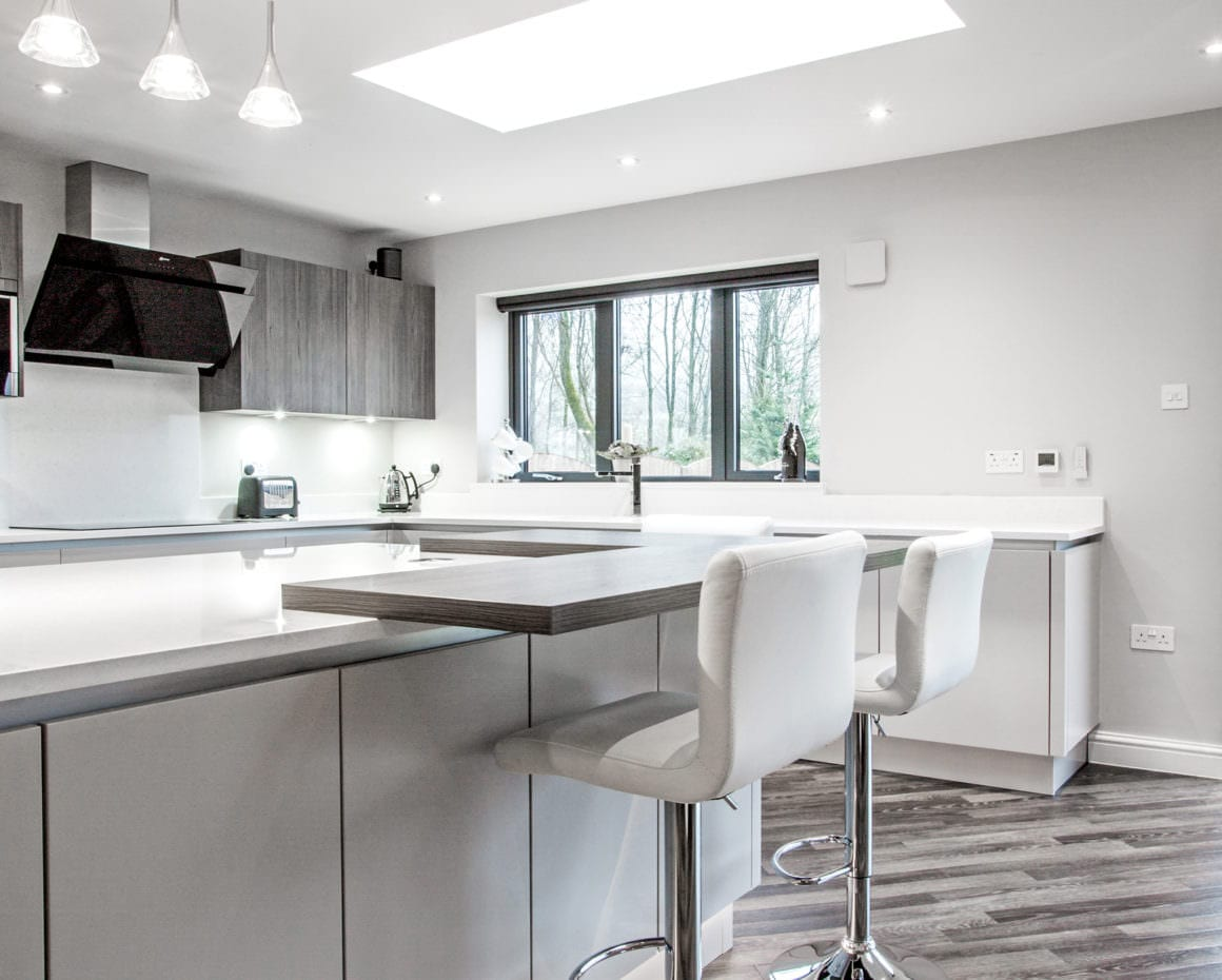 Full kitchen view showing breakfast bar and appliances